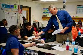 Picture of Principal Baugh with Students