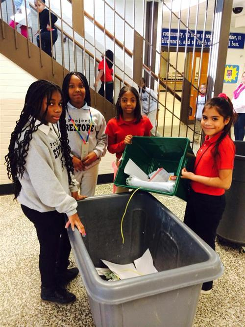 Arlington Woods School 99 students collect the recycling in their building.