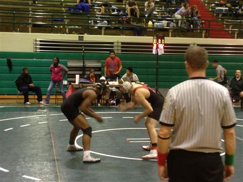An Arsenal Tech student gets ready to wrestle at competition.