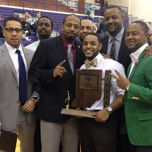 Crispus Attucks coaches pose with the Sectional trophy.