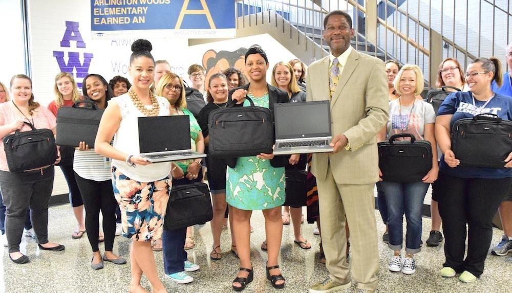 Eastern Star Church donates check and laptops to Arlington Woods School 99