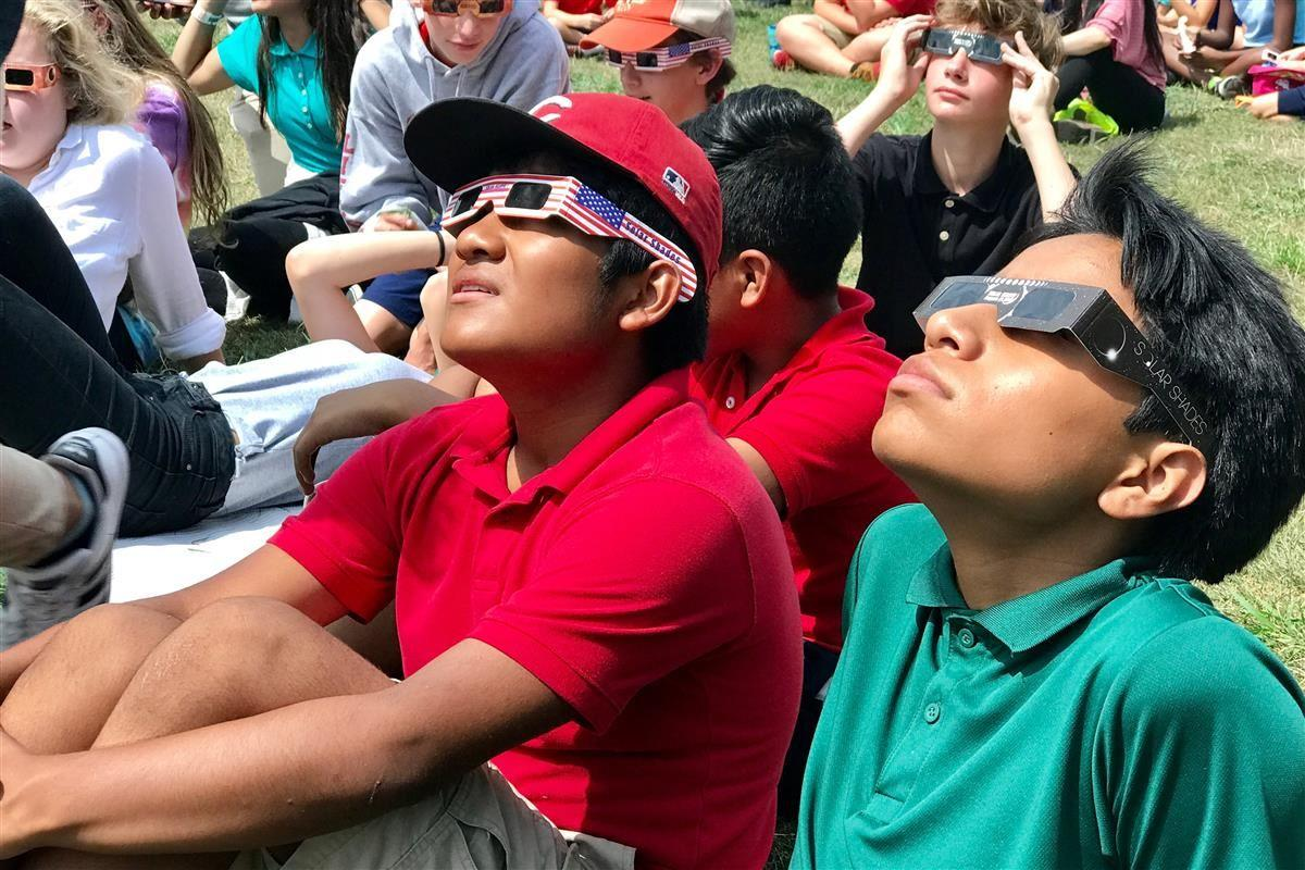 CFI students look at the eclipse
