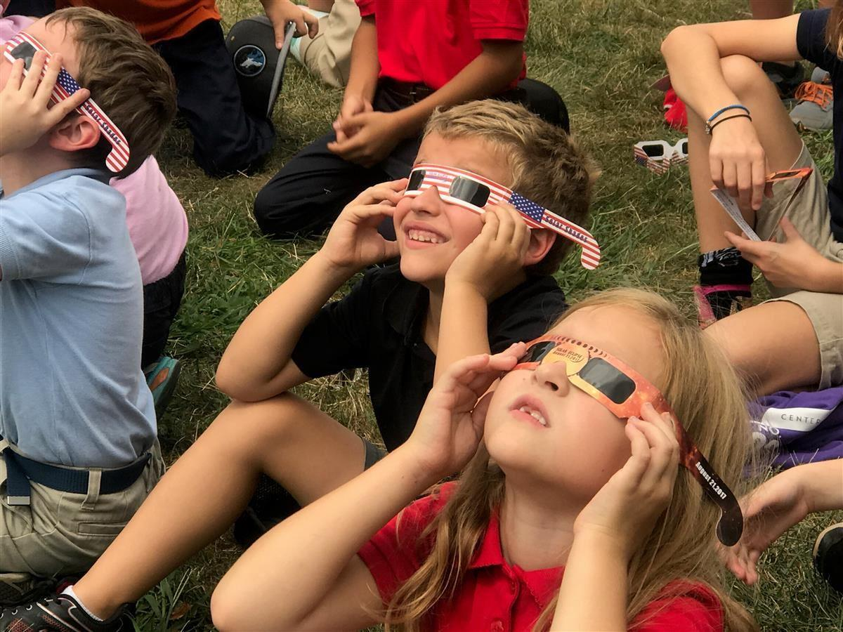 CFI 2 students watch the eclipse from American Legion Mall.