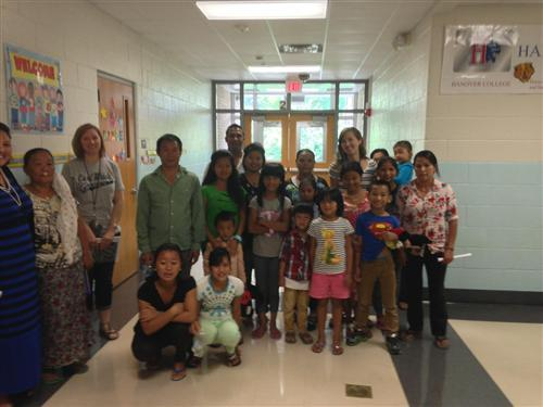 A group of refugee families tour Carl Wilde School 79.