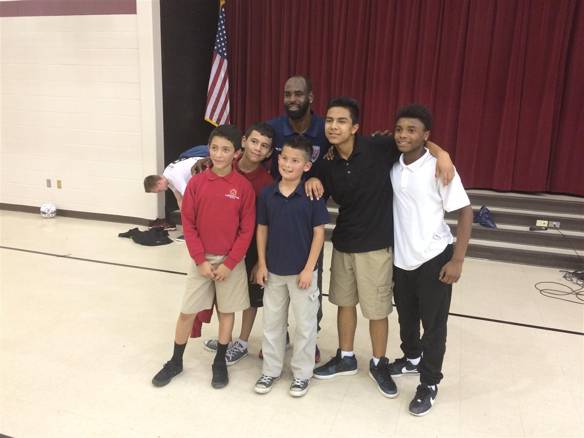 Indy Eleven midfielder Don Smart takes picture with students from Christian Park School 82.
