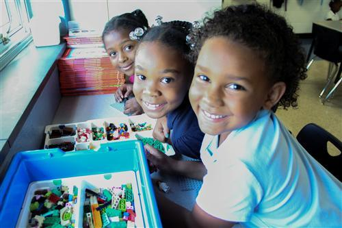 Students at Lew Wallace School 107 work with LEGO bricks during their literacy block.
