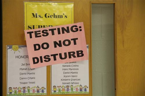 """Testing: Do Not Disturb"" sign on a classroom door."