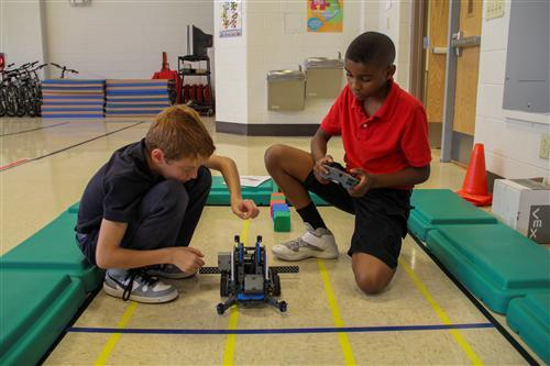 Cold Spring students work on their robot at practice.