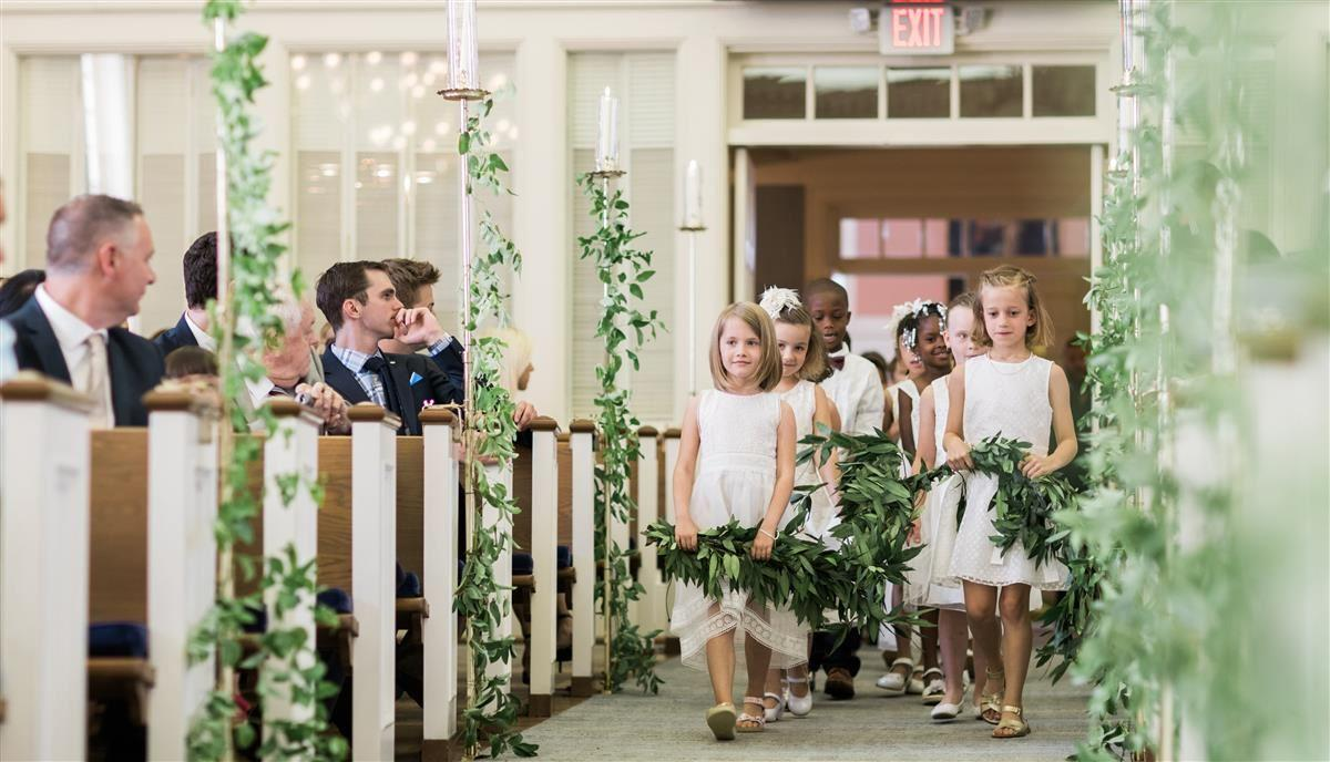 Butler Lab students asking down aisle at teacher's wedding