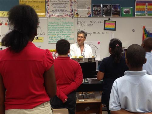 Mrs. Henry from Stephen Foster School 67 leads a music class.