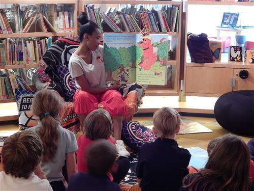 Indiana Fever hip hop Inferno dancer reads to students at the library.