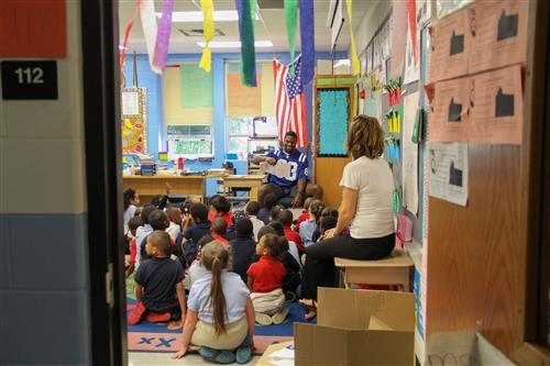 Indianapolis Colts player Dwayne Allen reads to students at Brookside School 54.