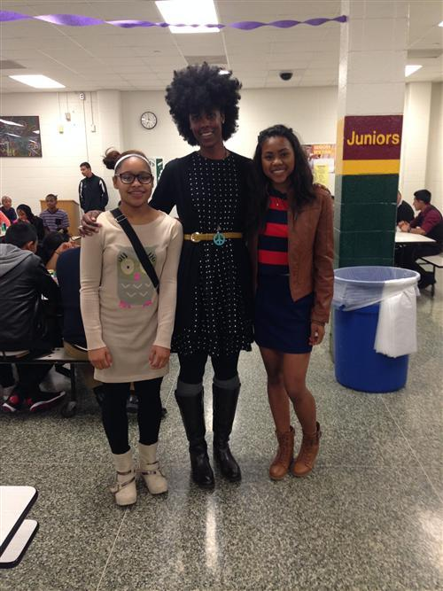 Crispus Attucks volleyball players with their coach.
