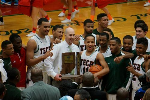 Arsenal Tech basketball team with their sectional championship trophy.