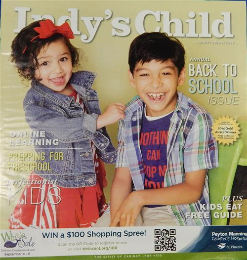 Two Hispanic children on the cover of Indy's Child magazine.