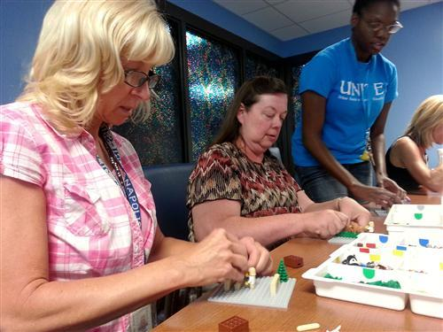 Teachers at Lew Wallace School 107 work with LEGO Story Starter kits.