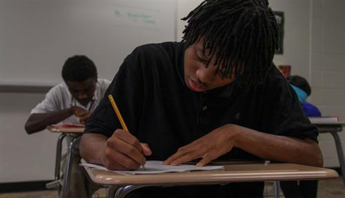 A student at Step Ahead Academy works diligently on their classwork.