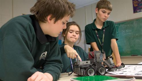 Harshman Magnet Middle School students work on their robot.